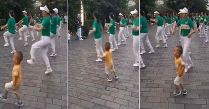 cute video of a little boy dancing with a group