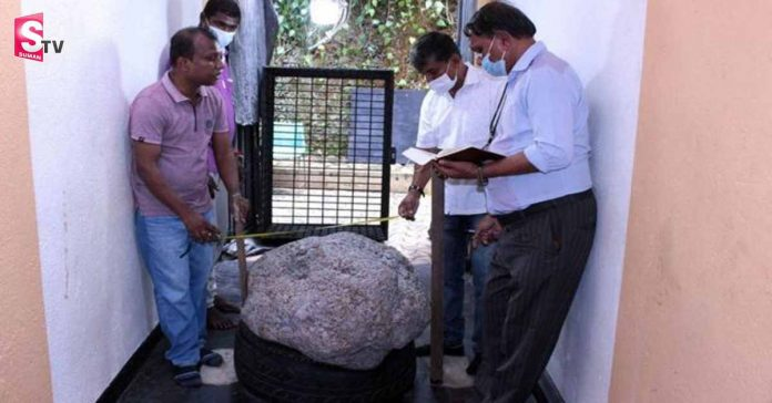 big stone infront of home