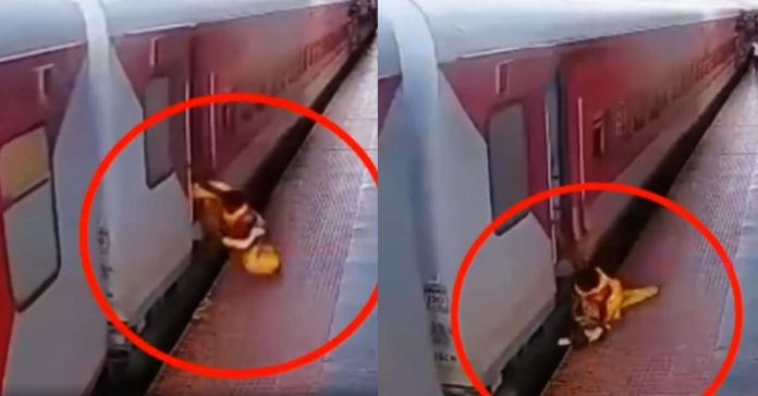 Woman and Baby falling off rails from running train viral video -Suman Tv